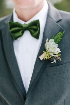 Wintery green velvet bowtie: http://www.stylemepretty.com/colorado-weddings/golden-co/2016/05/05/how-this-brides-childhood-home-inspired-her-winter-wedding/ | Photography: Lisa O'Dwyer - http://www.lisaodwyer.com/