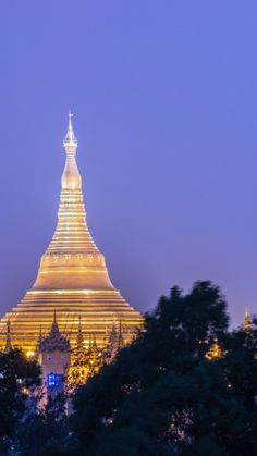 Floor-to-ceiling French doors lend for views the distant Shwedagon's magnificent stupas. #Myanmar