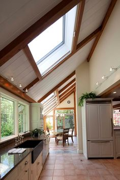 Love the roof line with windows in the ceiling and the windows above the sink: Post & Beam Kitchen by Yankee Barn Homes