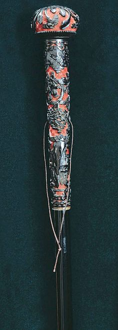 A very old Chinese walking stick carved from the dried sap of a cinnabar tree. It is an ancient Chinese design, representing a tradition of using cinnabar to create potions ensuring longevity. From the Ruth Gordon Walking Sticks Collection Cool Walking Canes, Walking Sticks And Canes, Cannes, Raising Canes, Cane Handles, Cane Stick, Sticks And Stones, Whittling, Wood Carving