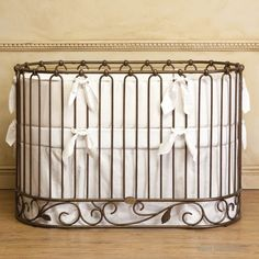 j'adore oval crib-cradle venetian gold by Bratt Decor with ivory bedding