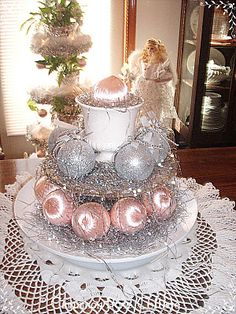 http://cinnamonrosecottage.blogspot.com/2011/12/pink-and-silver-table-top-tree-made.html