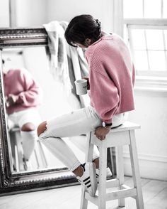 pink sweater, denim jeans, and lace up sneakers
