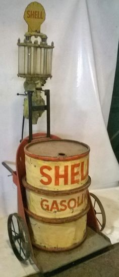 An UNUSUAL find! (was used on the set of the film Amelia! Old Gas Pumps, Vintage Gas Pumps, Fiat 500, Vintage Signs, Vintage Cars, Vintage Oil Cans, Pompe A Essence, Gas Service, Old Garage