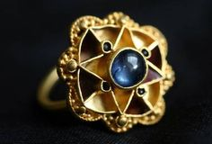 If I ever learn benchwork and advanced jewelry-making skills, I'm gonna make me one of these... Sapphire ring 'belonged to Anglo-Saxon or Viking royalty'