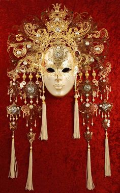 """Magnificent Duchessa"", € 1,728    ~ Hand-decorated mask, made in Venice according to traditional artisan techniques. Beautifully decorated with a large array of spray painted colours, high quality glitter, metal appliqués studded with Swarovski crystals and choice pearls.  Satin ribbon ties to fit the mask comfortably."