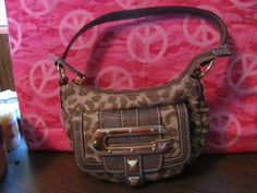 This hot little number will satisfy your every style craving    GUESS    WOMENS FAUX LEOPARD    SHOULDER HANDBAG    MINT CONDITION    FOR PREOWNED    ZIPPERED CLOSURE    POCKET WITH MAGNETIC    CLOSURE IN FRONT    1 MAIN COMPARTMENT    1 ZIPPERED CLOSURE INSIDE    6 IN HEIGHT    8.5 LENGTH    4.5 IN DEEP    8.5 IN STRAP DROP    SUPER CUTE & CLASSY    WONDERFUL ADDITION    TO YOUR WARDROBE