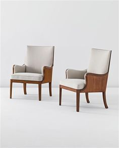 FRITS HENNINGSEN  Pair of armchairs, c. 1936  Produced by Master Cabinetmaker Frits Henningsen, Denmark. Shaped mahogany, mahogany-veneered wood sides and moulded back, linen (2).  Each: 94 cm (37 in) high