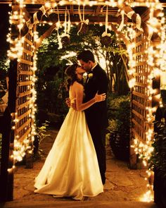 """Summer lights for summer nights!  Nothing says """"ROMANCE"""" like a kiss under the archway dripping with fairy lights.  *SWOON*  The secret to success is planning and taking time to do things right.  NOTE:  See how the lights get extra """"oomph"""" from the white ribbon/bias tape?  Ties them on and brightens things up a bit.  GREAT JOB!"""