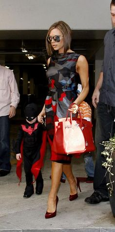 Victoria Beckham wearing Christian Louboutin Rolando Pumps in Red Patent Leather, Hermes Birkin Bag in Red Leather, Marc Jacobs Abstract Floral Print Dress and Dvb Mirrored Aviator Sunglasses.