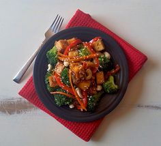 Chilli Ginger Vegetable & Tofu Stir Fry Recipe Main Dishes with extra firm tofu, broccoli florets, red pepper, carrots, onions, garlic, ginger, chili flakes, whole cashews, sesame seeds, soy sauce, hoisin sauce, vegetable oil, salt, pepper