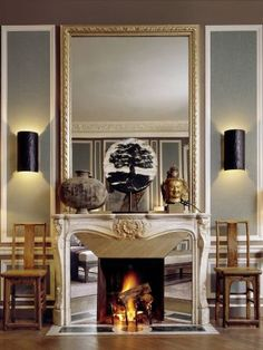 Traditional Living Room by Christopher Noto in Paris, France.  Antique mirror right around the fire opening.