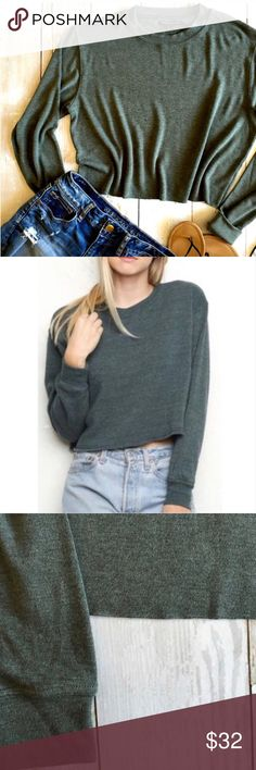 "NWT Brandy Melville Cropped Nancy Sweatshirt NWT Brandy Melville lightweight heathered olive green Nancy sweatshirt.  Super soft and comfy.  * Crew neck * Cut Cropped hem * 21"" long  🚫Trades Brandy Melville Tops Sweatshirts & Hoodies"