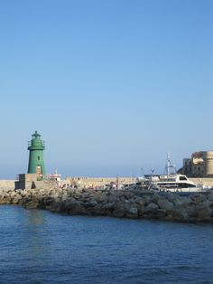 The Green Ligthhouse at the small harbour of Giglio Island, #maremma, #tuscany, #italy