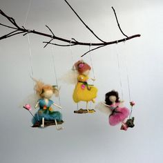 83.00Waldorf inspired felt fairy mobile with 3 fairies in vivid colors on swings. The mobile is made out of natural materials – deep red branches, wooden
