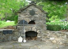 Outdoor bread oven in Vermont by Champlain Valley Landscaping. www.champlainvalleylandscaping.com
