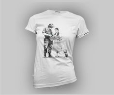 Banksy Stop and Search T-shirt -Women's Slim-fit – £15    http://banksyt-shirts.com/banksy-stop-and-search-t-shirt-womens-slim-fit/    The Stop and Search print was released at the end of '07. It was sold from Pictures on Walls 'Santa's Ghetto' shop which was based in Bethlehem that year! The edition was of 500 all signed 2 colour screen-prints. This was the first time Banksy released all of his prints as signed copies.    You don't have to spend £ 6k to enjoy this design. Just buy this…