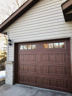 Amarr Designer's Choice Garage Door in Walnut with Thames Windows.  Installed by Augusta Garage Door in St. Cloud, MN. #garagedoor #garagedoors #amarrgaragedoors #steelgaragedoor #homeimprovement #carriagehousedoor #woodlookgaragedoor #homeimrovement #curbappeal #stcloudmn