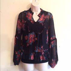 United Colors of Benitton Navy Floral Henley Feminine floral print in a soft sheer material with a ruffle lining. Ruffle accent sleeves and hem. Side zipper. 100% polyester. No trades. Generous discount with bundle. United Colors Of Benetton Tops Blouses