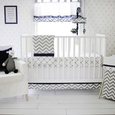 Inspired by the popular chevron pattern, the Out of the Blue baby bedding set will give your nursery a modern, clean look. Navy, grey and white will give your nursery a fresh feel for your brand new baby boy.