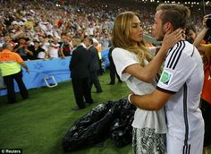 Sealed with a kiss: Scorer Mario Gotze celebrates with girlfriend Ann-Kathrin Brommel after the final whistle in Rio de Janeiro