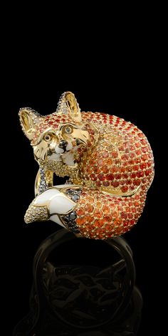 *** Wild savings on wonderful jewelry at http://jewelrydealsnow.com/?a=jewelry_deals *** From the Animal World Collection:  18K yellow gold ring with white & black diamonds, orange sapphires, and enamel.