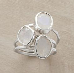 Light and color reveal their myriad beauty in three stacking moonstone rings. Handmade. Sterling silver. Imported. Whole sizes 5 to 9. Set of 3.