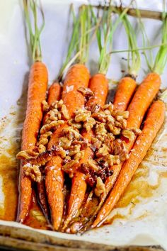 These Brown Butter Honey Glazed Carrots are whole carrots baked in brown butter and honey and topped with toasted walnuts. They are a deliciously sweet and savory addition to your Thanksgiving table.