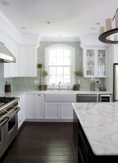 hand scraped floors in kitchen - w/ white marble counters