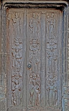 Apostle's door, Berkeley Castle, Berkeley, England. It was originally carved by Flemish workmen and brought into this country during the 16th.century. The door was made with 12 figures but was too large for the castle entrance so it's size was reduced by cutting it down with the loss of three Apostles!