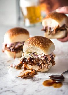 This Slow Cooker BBQ Pulled Pork Sandwich is made with tender pork smothered in BBQ Sauce and topped with Coleslaw. Finger lickin' good!