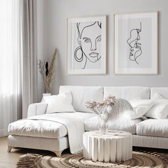 Clean, white interior + Framed Posters #livingroom #minimalism #artprints #posters #walldecor #wallart #poster #frames #interior #inspiration