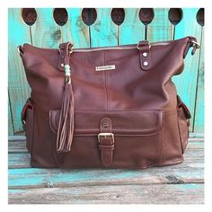Make your life easier with a 16-pocket, removable organizer that keeps everything at your fingertips, AND three carry options, including backpack, to keep your hands free. On sale now! @ashleeknichols #backpack #handbag The Meggan