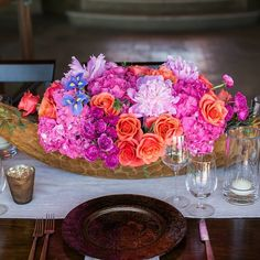 #TBT to this floral centerpiece Elena designed in bold, happy colors using pink hydrangea, coral roses, magenta sweetheart roses, blue irises, and pale pink peonies. 📷: @chrispluslynn #brightflowers #floralarrangements #centerpieces #elenadamy #floraldesign #floraldesigner #cabofloraldesign #destinationweddings #marryincabo #partyincabo #eventprofs #eventplannerscabo