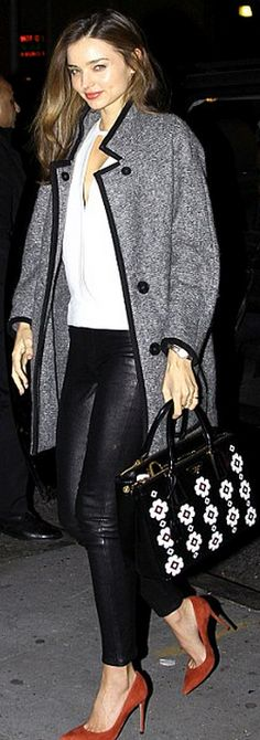 Who made  Miranda Kerr's gray coat, white cut out top, floral black purse, and burnt orange suede pumps that she wore in Los Angeles?