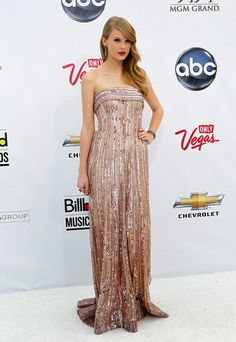 styledbykarina.com  Taylor Swift in a rose gold gown by Elie Saab