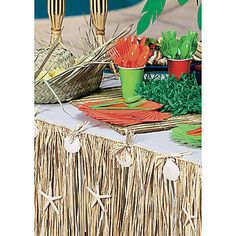 Use the Raffia & Seashell Table Skirt to dress up your luau tables or beach themed buffets.