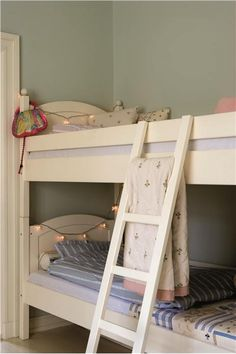An inspirational image from Farrow and Ball - A children's bedroom with walls in Teresa's Green Estate Emulsion and bunk bed in Wimborne White Estate Eggshell.
