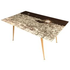 Fornasetti Glass and Brass Coffee Table | From a unique collection of antique and modern coffee and cocktail tables at https://www.1stdibs.com/furniture/tables/coffee-tables-cocktail-tables/