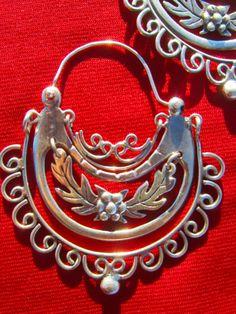 Big silver earrings. (These arracadas from fridasjewelry on etsy.)
