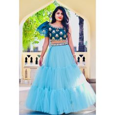 Stunning ice blue color skirt and designer crop top with puff sleeves. Blouse with hand embroidery gold thread work.  29 January 2019