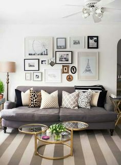 i love the positioning of these pictures.... hmmm idea for my living room