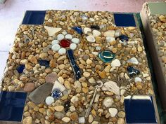 Blue Conversation Stone by Fiddlekate (Katie Waller), via Flickr  The idea was to put in things: coins, jewelry, shells, keys, broken plates, etc. that might be interesting or family specific so that children and grandchildren will enjoy looking at them at talking with you/me :) about what all of the things are.
