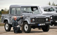 Seriously shaken but not stirred: Land Rover technician, Dave Larkin, reviews the surviving Land Rover Defenders used in the opening sequence of James Bond: SKYFALL as they arrive at Land Rover HQ, bullet holes, dents and all. Twelve identical Defenders were used to film the opening stunt sequence, when Bond girl, Naomi Harris drives a Defender double-cab pick-up during a classic Bond chase. Not all twelve survived the filming but those that did have been returned by Pinewood Studios to Land…