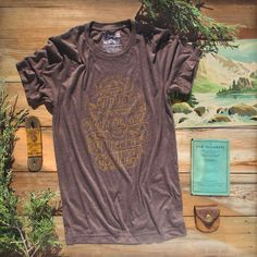"Christian T-Shirt with adventure theme and Proverbs 3:5-6 ""With all your heart trust Him, in all your ways acknowledge Him, & He will direct your paths."" This scripture shirt is handcrafted and screenprinted on a gloriously comfy chocolate brown triblend tee. Quality Christian clothing for women and men. FREE SHIPPING USA.  Shop >> MercyRoadApparel.com"