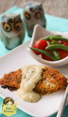 """Ritzy Cheddar Baked Chicken - This gorgeous chicken is baked with a cheesy, crunchy, buttery crust and topped with a yummy sauce that couldn't be simpler.  It's sure to beat your regular old """"oven baked chicken"""" with a lively cheddar flavor, a crispy exterior coating, and that juicy interior that you love."""