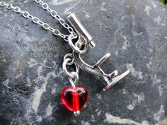 Microscope necklace - sterling silver charm & red heart - science teachers, lab techs, and microbiolgists - she blinded me with science. $30.00, via Etsy.