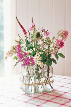 Vintage Milk Bottles This arrangement—featured in Decorating with Flowers by Paula Pryke—gets its charm from vintage milk bottles tied together with gardener's twine.
