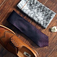 The groomsman essentials: wing-tipped shoes, patterned tie, pocket square, and boutonnière.
