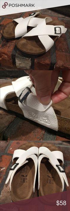 Birkis by Birkenstock white slide sandals size 38 Birkis by Birkenstock white slide sandals size 38.  Gently used condition.  White strappy slides Birkenstock Shoes Sandals